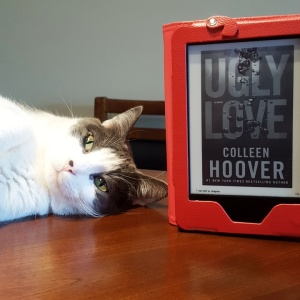 Voldemort, enjoying 'Ugly Love'. The non kindle cover is beautiful and vibrant, FYI.